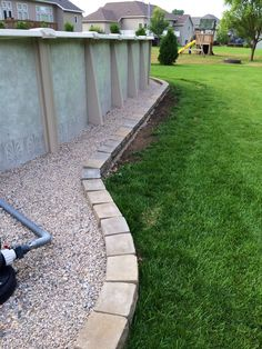 Edging around pool made of retaining wall pavers