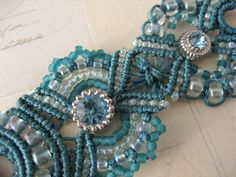 Sherri has a wonderful ability not just to add beads to her micro-macrame technique but she also includes focal beads. Description from…