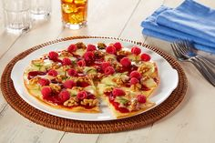 This Raspberry Brie Pizza is decorated with Rosemary and Walnuts. Serve it as a sweet seasonal appetizer or dessert.