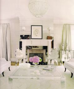 I'm loving lucite these days. What a dreamy room!