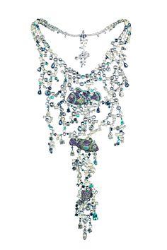 Clownfish plastron necklace in white gold set with 105 carats of moonstones, aquamarines, blue sapphires, pastel blue sapphires, blue topazes, icy quartz, Paraiba tourmalines, pear-cut diamonds, diamonds, amethysts, apatites, chalcedonies and tsavorites