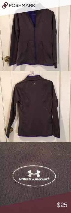 Under Armour zip-up *NYC* This is perfect jacket for a light run or for keeping you warm on the way to your yoga studios. My favorite part, personally, is the bright purple liner. In good lightly used condition; I would say this fits slightly on the small side. Under Armour Jackets & Coats