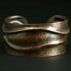 Copper cuff bracelet, roll printed and pressed, one-of-a-kind. $68.00, via Etsy.  I was intrigued how she could maintain that lovely texture with fold forming. Turns out she uses an hydrolic press rather than beating the heck out of it with hammers.  Beautiful!