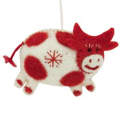 Fair Trade from Nepal. This sweet red and white cow ornament will moo-ve your heart into the Christmas spirit!