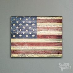 This 16x20 canvas shows off the stars and stripes fading from old wood planks. A beautiful addition to any room.    This decoration comes ready to