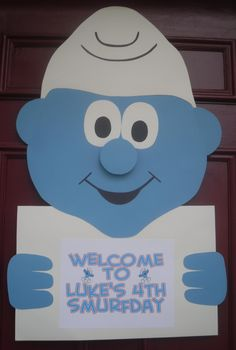 Smurf Party Door Sign. Poster board, tp roll gives dimension to the nose.