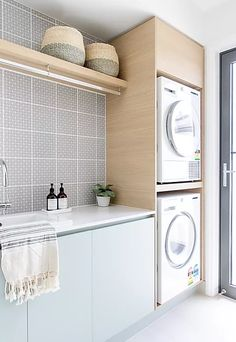 Laminex Spinifex combined with Laminex Aged Ash make this laundry simply beautiful. Essastone Crystallite tops. Laundry Cabinets, Laundry Room, Kitchen Interior, Kitchen Design, Laundry Design, Stacked Washer Dryer, Houzz, Master Bathroom, Home Appliances