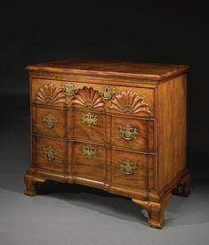 Important Jeremiah Sheldon Chippendale Block- and Shell-Carved And figured Mahogany chest of drawers, Attributed to John Townsend, Newport, Rhode Island, circa 1765 - Appears to retain its original highly elaborate brass hardware; drawers inscribed A, B, C in chalk. Also inscribed Back in graphite twice on the back board of two drawers, and with a cabinet shop mark, a chalk letter B on the lower back board.  Height 32 in. by Width 35 1/2 in. by Depth 19 3/4 in.; Case Width 33 3/4 in.