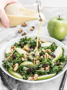 Apple Dijon Kale Salad - Homemade Dressing - Budget Bytes This Apple Dijon Kale Salad is tangy, sweet, and crunchy with Granny Smith apples, walnuts, raisins Kale Apple Salad, Apple Slaw, Kale Salad Recipes, Slaw Recipes, Vegetable Recipes, Vegetable Salad, Veggie Food, Healthy Eating Recipes, Vegetarian Recipes