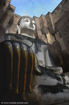 """Sukhothai was the first capital of ancient Siam. What remains of the kingdom today are the ruins of the royal palace and of 26 temples.This UNESCO site is a 5-hour drive from Bangkok and is the home of the white giant seated Buddha Translated into English, Sukhothai means """"Dawn of Happiness"""". http://www.islandinfokohsamui.com"""