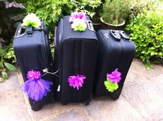Prettiest luggage identifiers. #pompoms #tissueblossoms