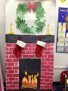 """Holiday chimney for the classroom"" Materials: bulletin board paper, construction paper, tape, glue, scissors, stockings and thumb tacks"
