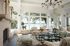 Lovely, light living room! Plenty of room to entertain or enjoy the view of the lake out the great windows.
