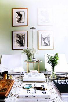 Love the mint green walls, black and white sketches and a selection of perfectly curated coffee table books.