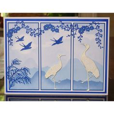 handmade card using Tattered Lace Dies ... Asian theme ... monochromatic blue ... three panels ... white die cut cranes ...  gorgeous ...