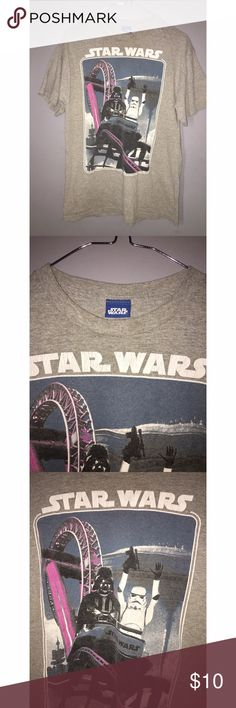 STAR WARS Darth Vader and Storm Trooper T shirt Star Wars amusement park t-shirt. Features Darth Vader and a Storm Trooper on a rollercoaster. The size tag has been cut out but looks like an adult medium. Check out the pictures so you can see how the image is crackled from age and wash. Please ask any and all questions prior to purchase. Shirts Tees - Short Sleeve