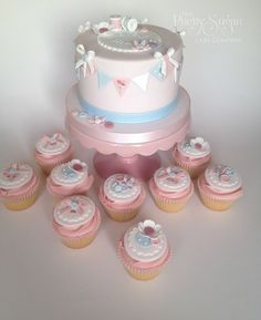 Pretty buttons, bows and flowers cake and matching cupcakes - sew lovely!