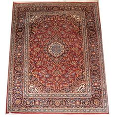 Intricate red rug.