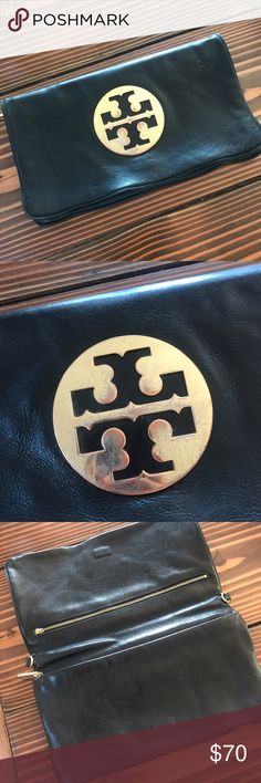 Tory Burch Black Leather Clutch Black leather Tory Burch Reva clutch with gold-tone hardware. Logo placard at front face, dual interior zip compartments (top zipper is missing the clasp but still works), tonal woven lining and concealed magnetic closure at flaps. The gold hardware is a bit tarnished (as shown in photo). No trades. Offers welcome. Tory Burch Bags Clutches & Wristlets
