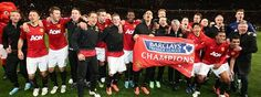 The Manchester United squad celebrate after clinching the 2012/13 Barclays Premier League title