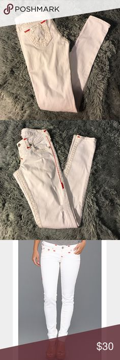 True Religion Stella Super T White Skinny Jeans 🔥 True Religion Stella Super T White Low Rise Skinny Jeans with Thick Cream & Red Stitching 🔥🔥🔥       (Size 26)   In AMAZING CONDITION!!! Looked over very very thoroughly no spots or stains ( I do this with anything in my closet or I won't list it, even if i find a tiny stain!!!) Thicker jean with moderate stretch                   98% Cotton / 2% Spandex True Religion Jeans Skinny