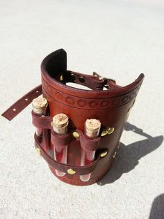 Hand Tooled Leather Alchemy Steampunk Costume Bracer with Vials. $75.00, via Etsy.