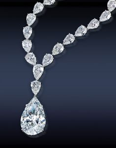 "Jacob & Co. Pear-Shaped GIA Certified 23.52Ct. G VVS2 Diamond Is A Detachable Pendant, Mounted In 18k White Gold, Surmounted By 44.15Ct. Pear Shape Diamonds 17"" chain (24 GIA Certified) Mounted In Platinum."
