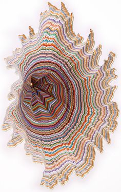 American artist, Jen Stark, creates three-dimensional pieces which take paper to a whole new level. She is famous for layering paper into kaleidoscopic topographical landscapes of wild color and bold shapes.