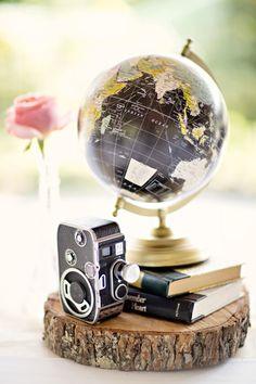 Vintage globe and camera wedding accents: http://www.stylemepretty.com/alabama-weddings/2015/11/11/elegant-blush-southern-military-wedding-in-alabama/ | Photography: Glass Jar Photography - http://glassjarphotography.com/index2.php#!/HOME