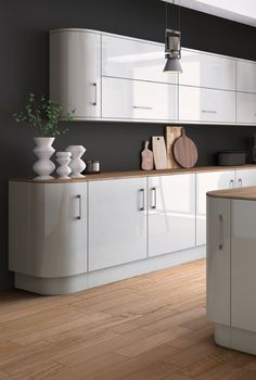 Choose the dark side! Dark walls will be a big trend in 2017. Team light grey kitchen cabinets with dark grey walls. Were loving the colour Down pipe by Farrow & Ball. By painting the walls so dark it gives a dramatic look but keeping the cabinets light and glossy allows light to be reflected. #kitchenstyle #darkinteriors #homedecor Cabinet doors in Zurfiz acrylic light grey at £36.64 to fit a 500 base unit.