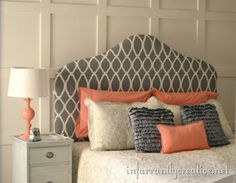 Gray, cream & orange; fantastic, striking colors for a bedroom. Love the cloth headboard...and such cute patterns.