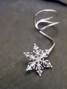 Hey, I found this really awesome Etsy listing at https://www.etsy.com/listing/111483530/sterling-ear-cuff-snowflake-intricate
