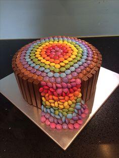 Smarties waterfall cake with kitkat. Chocolate birthday cake. Rainbow smarties.