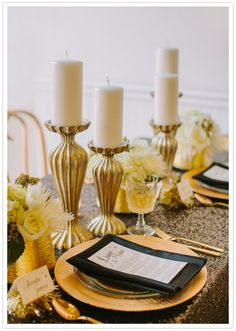 Use inexpensive candle holders (spray gold if needed); white candles and black ribbons