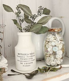 Cream and green color combo. Such a cute vintage feel in this photo with the bottle used as a vase and old buttons in a jar.