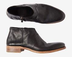 Neat ankle boots hand made in Portugal from supple, grained, calf leather. Leather lined. Leather sole with crepe inset. Fastens with zip puller at side.