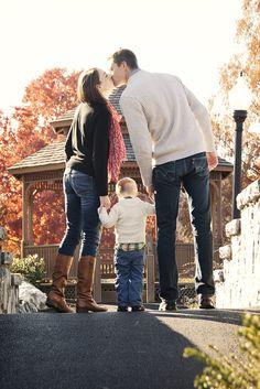 Family photo.... sneak a kiss above toddler