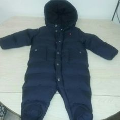 Ralph Lauren polo snow suit Baby boy size 6 months. Navy blue w/red polo horse. Excellent condition still like new .button Dan snaps and zipper. 2 front pockets. Feet closed in.hooded. Ralph Lauren Jackets & Coats Puffers