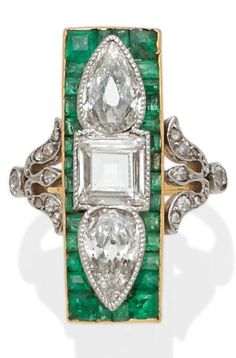 An early Art Deco diamond, emerald and platinum-topped gold ring, circa 1915. Centring a square step-cut and two old pear-shaped diamonds; estimated total diamond weight: 1.90cts. #ArtDeco