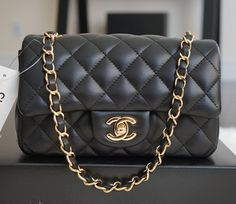 Chanel Lambskin Classic Mini Flap With Gold Chain Shoulder Bag. Get one of the hottest styles of the season! The Chanel Lambskin Classic Mini Flap With Gold Chain Shoulder Bag is a top 10 member favorite on Tradesy. Save on yours before they're sold out!