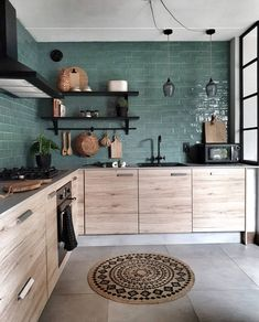 The texture of the wood cabinets against the lines of the green tile backsplash. This kitchen does balance right! ( The texture of the wood cabinets against the lines of the green tile backsplash. This kitchen does balance right! Kitchen Decor, Home Decor Kitchen, House Interior, Bohemian Kitchen, Kitchen Interior, Home Kitchens, Interior, Kitchen Remodel, Home Decor