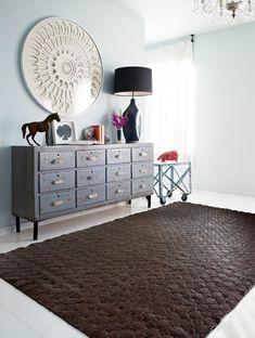 interlocking leather rug in dark brown in the living room
