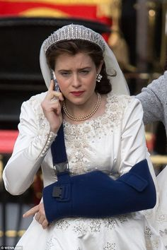 Quite the anachronism: Ruining the effect of the regal drama of the day, Claire chatted away on her phone while in her stunning costume