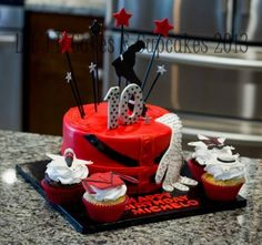 Created by Lit'l D Cakes & Cupcakes: Michael Jackson Thriller jacket birthday cake and cupcakes.