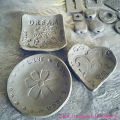 Some of my newest inspirational candle/ring dishes just sculpted out... Can't wait to see how they will turn out once glazed! They will be available in the shop once done! :)