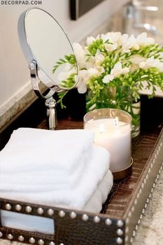 MD - tray with hand towels, candle fresh flowers for powder room