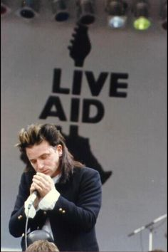 U2 | Live Aid 1985 - money raised was for famine releif in Africa...raised my awareness and was a 3 day concert that I watched mesmerized continuously...
