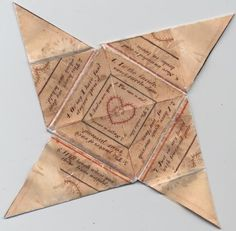 A version of an antique puzzle purse using origami folding. Great to make using calligraphy! It folds to show another heart like the center one, dotted on both inside and outside of the heart border. The message is numbered 1 thru 8, and the very interior around the pink heart is also numbered: 1 thru 4.