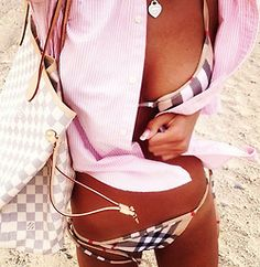 Burberry bikini, LV bag, Ralph Lauren polo shirt, Tiffany & Co. Necklace.