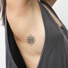 tattoo on rib